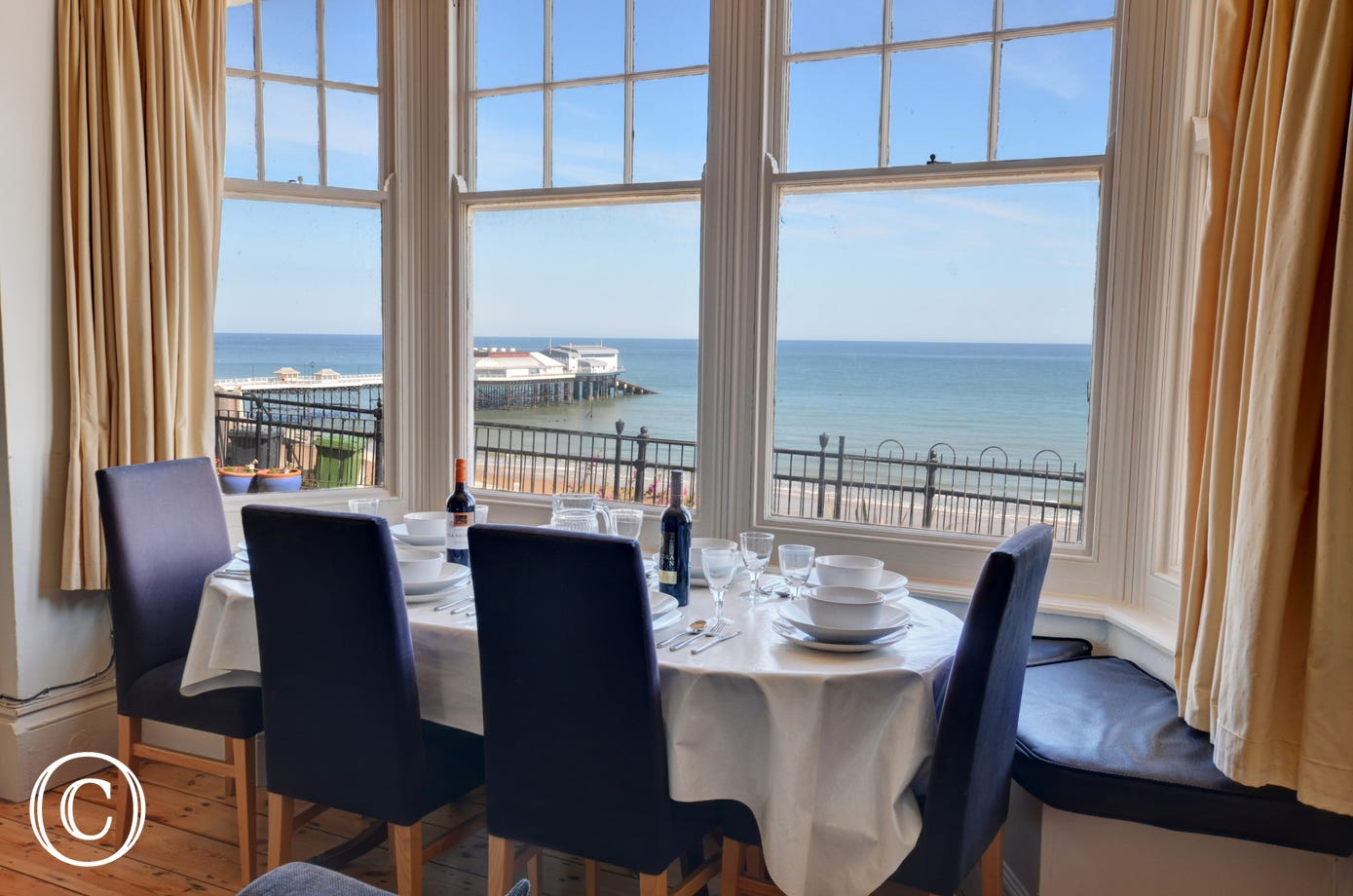 The dining area by the window has stunning views to the sea.