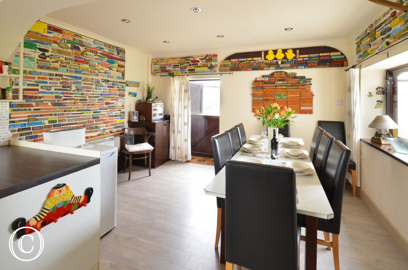 A stunning room with unusual artwork on the wall created by family and past guests