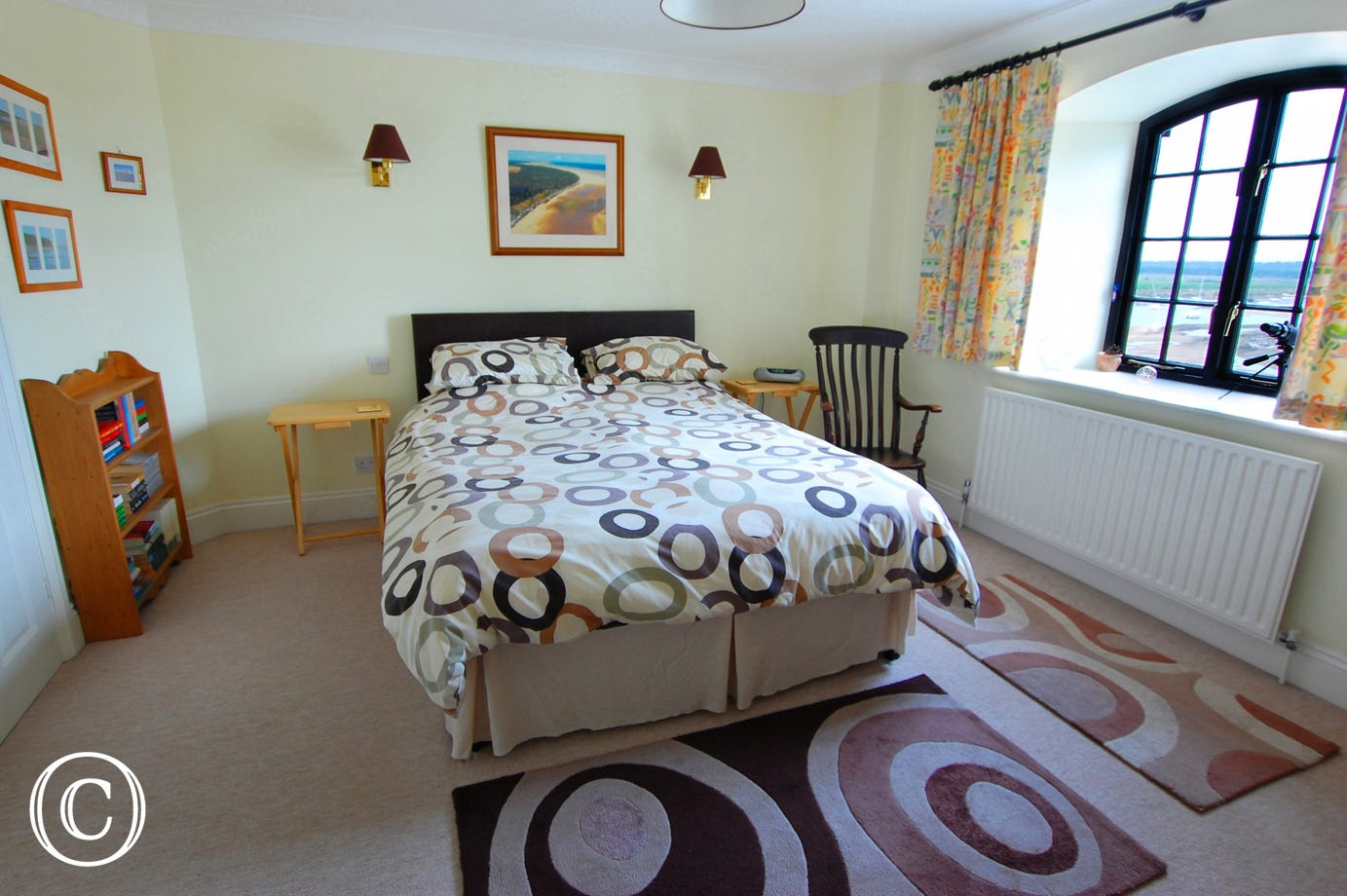 A double bedded room with views out to sea.