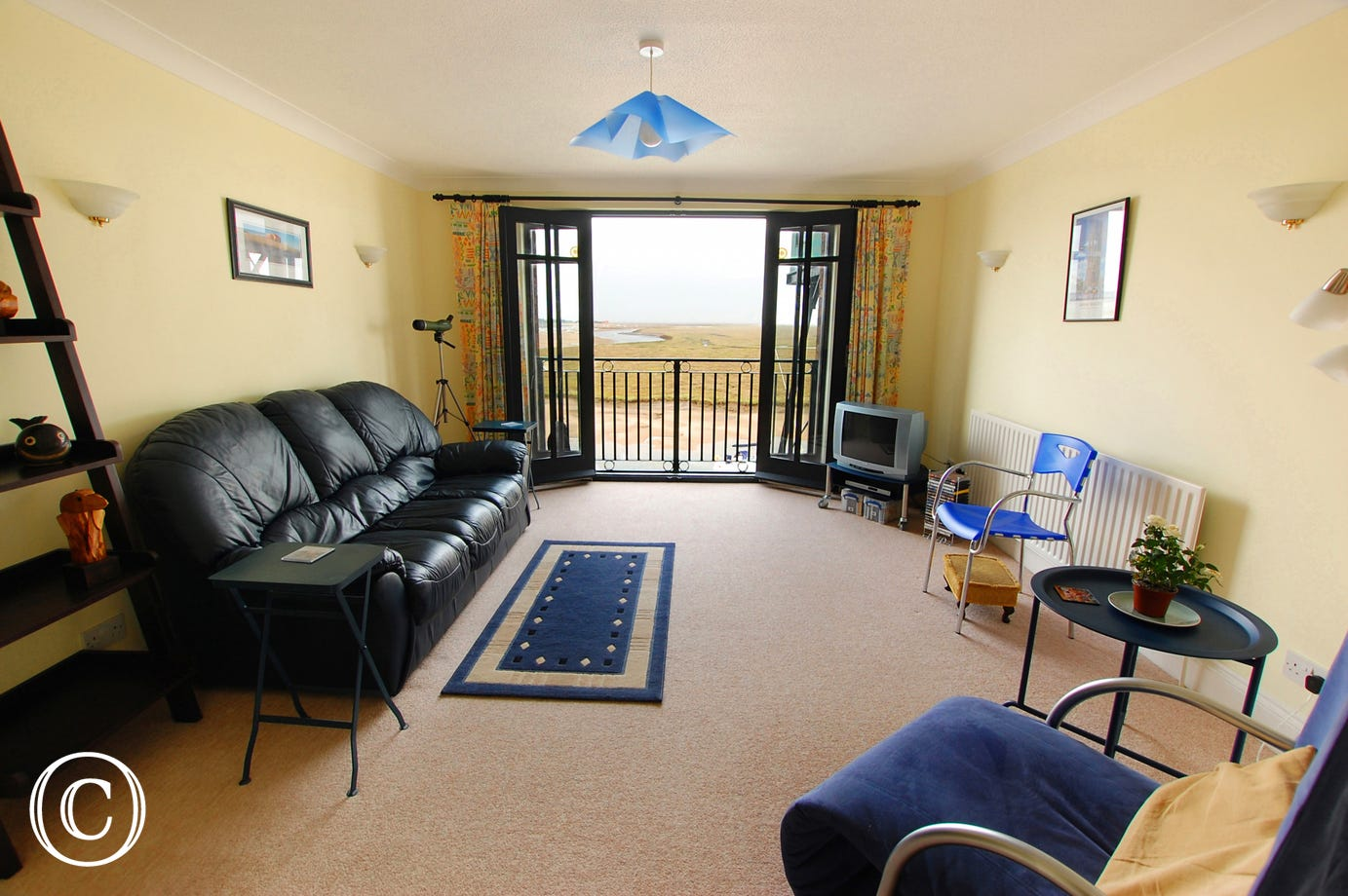 A comfortable room with spectacular views across Wells harbour through the French windows.