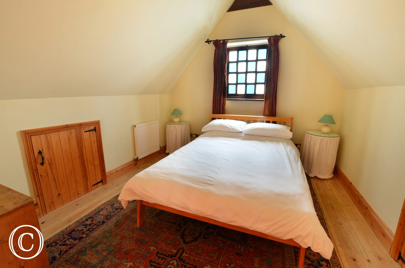 A comfortable and cosy double bedded room.
