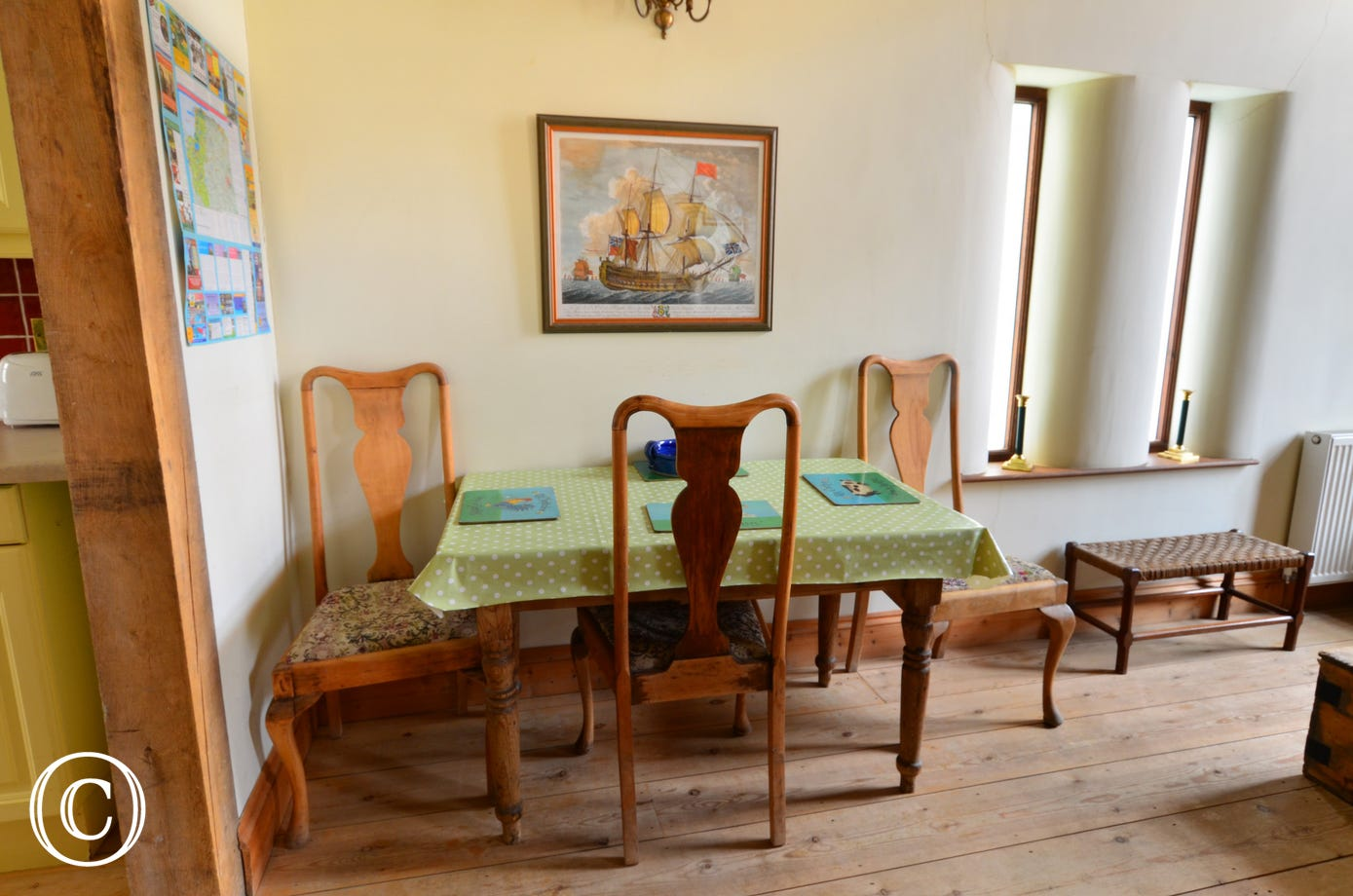 A dining table and chairs in one corner of the sitting room, perfect for family meals