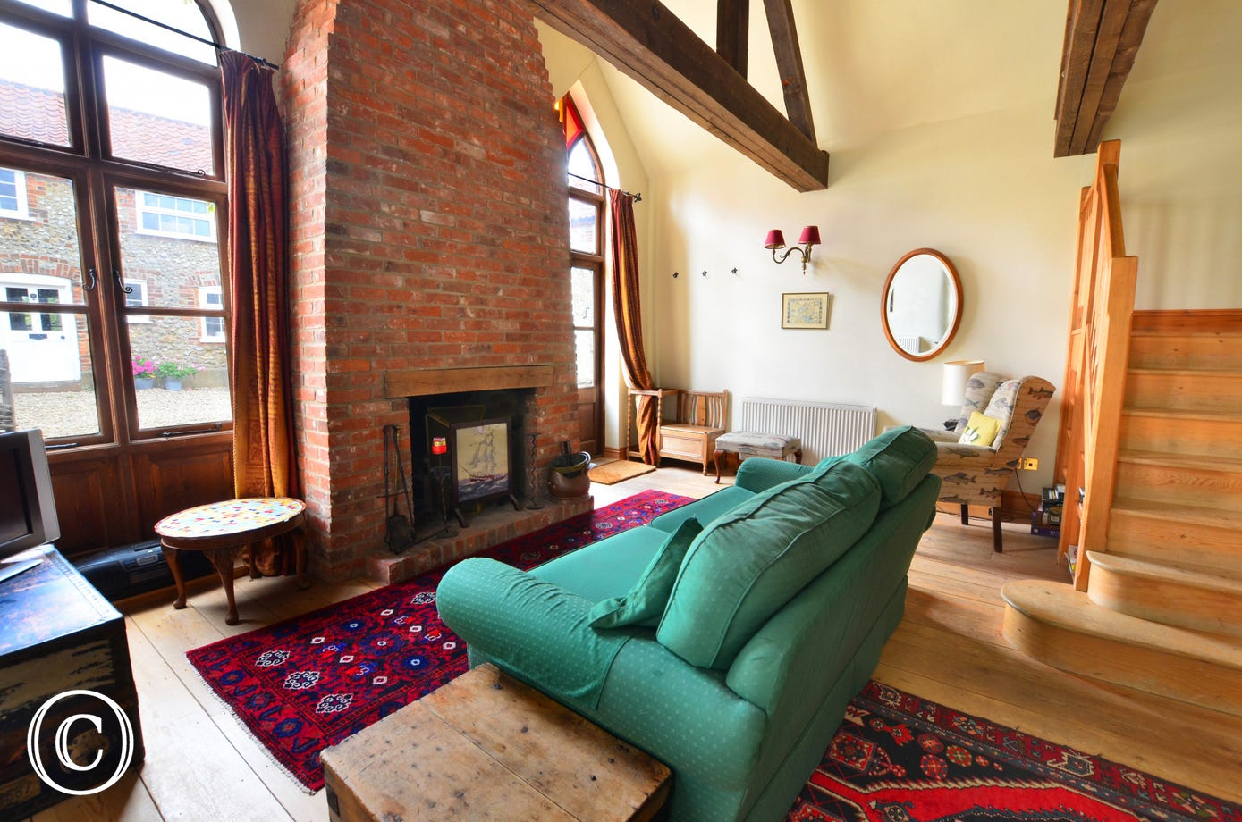 Characterful sitting room with an inglenook fireplace as a feature for cosy evenings