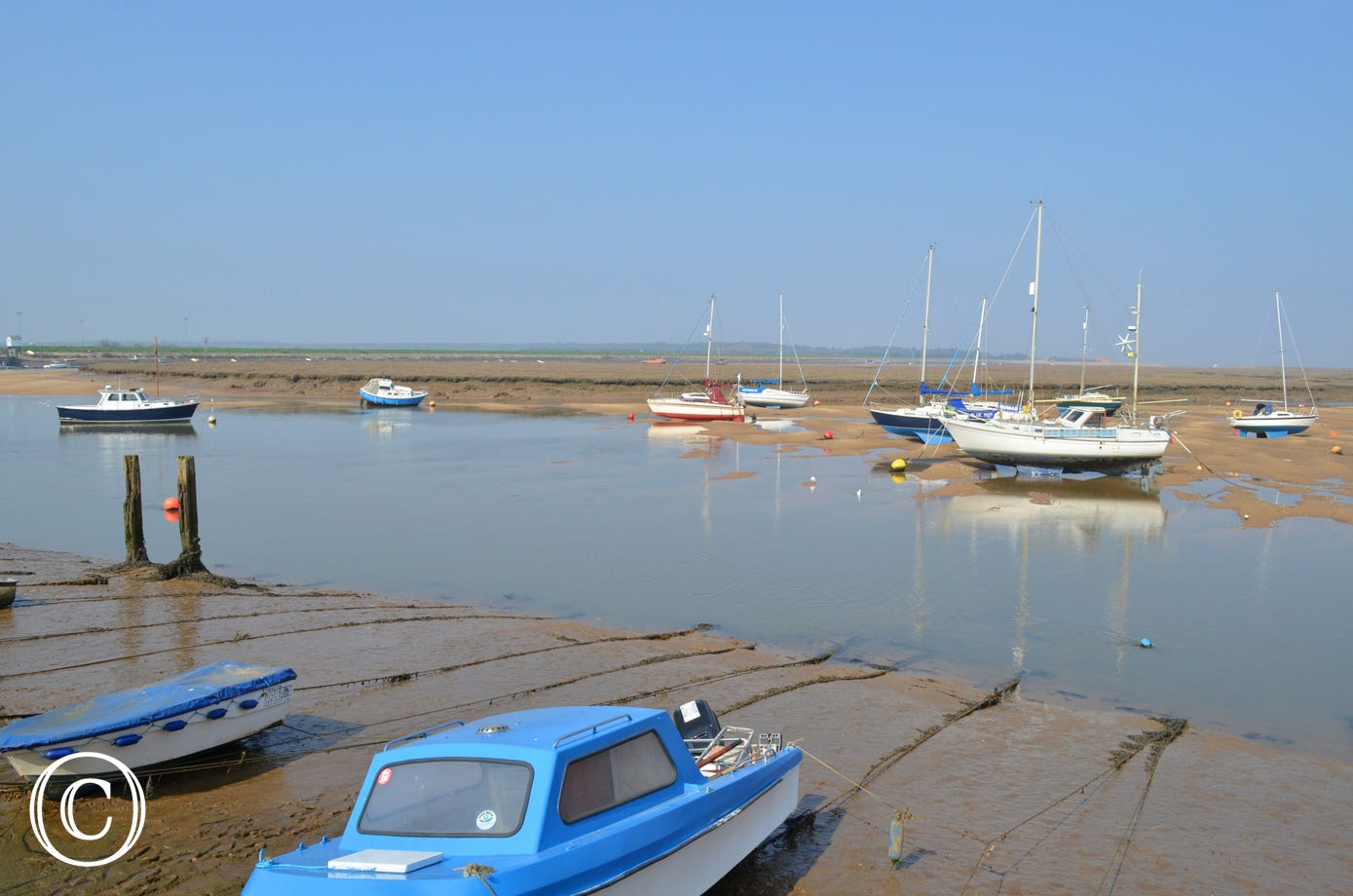 Sailing boats in Wells harbour.