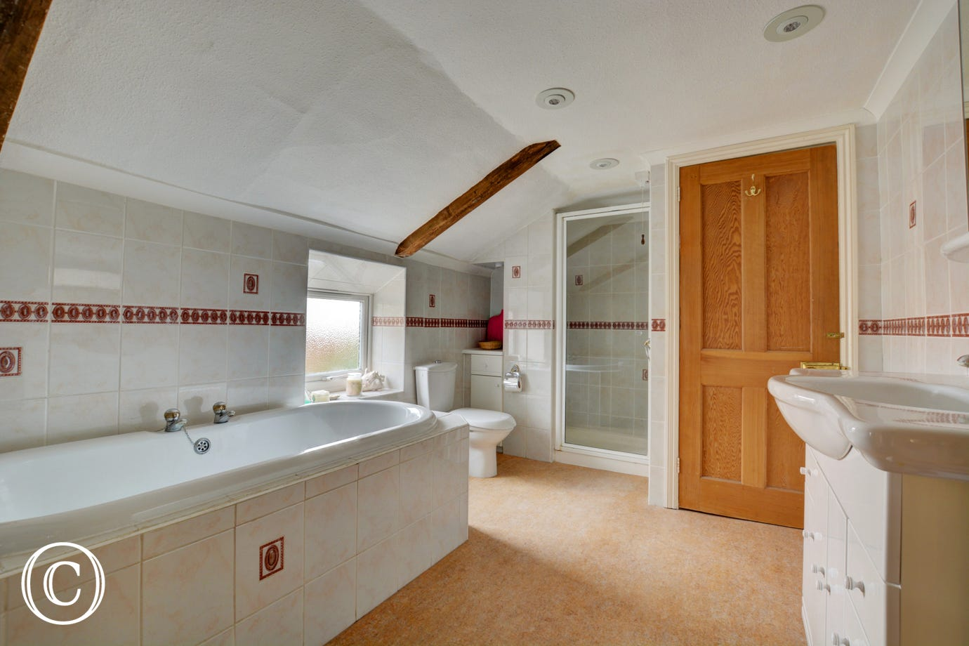 Modern and bright bathroom with bath and separate shower cubicle