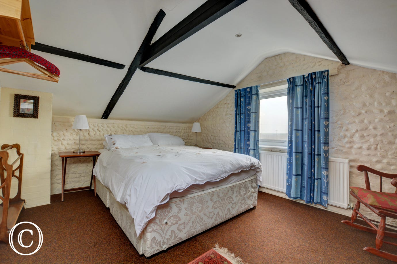 This double bedroom has a king-size bed and En-suite shower room which is accessed from the landing