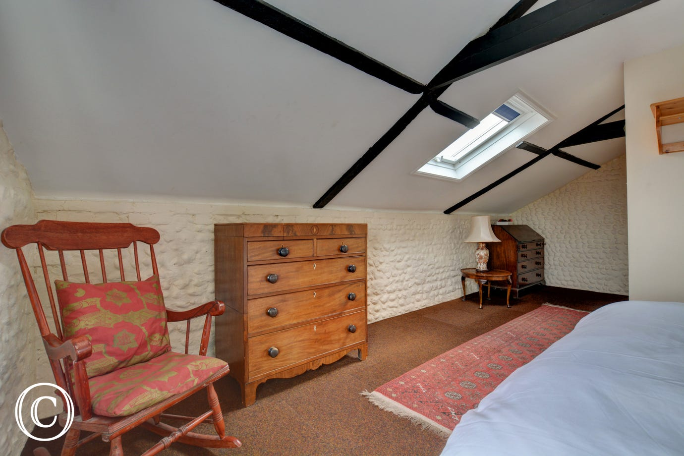 Bedroom one has a king sized bed and the added convenience of an en suite shower room.