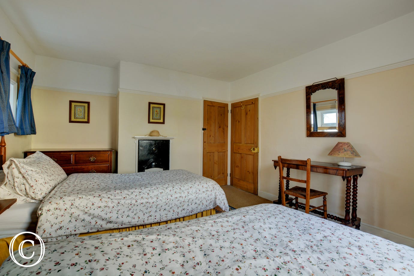 Twin beds and dressing table area in the second bedroom.
