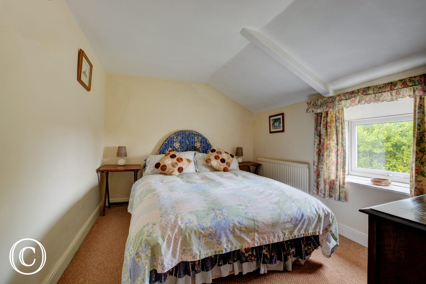 Country style double bedroom with a double bed