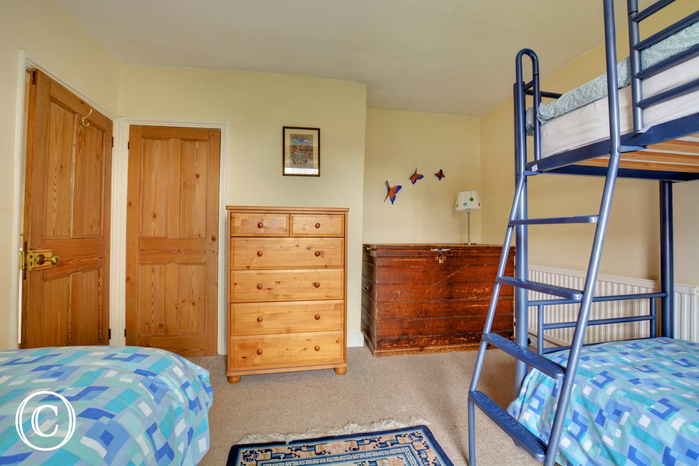 Bunk beds and two single beds in bedroom 4, perfect for children.
