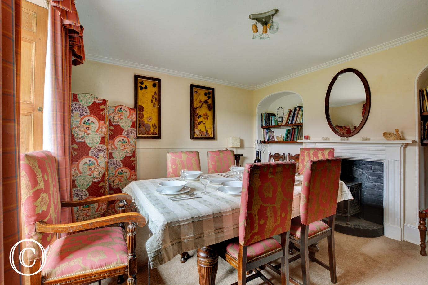 Traditionally furnished dining room with a table and chairs, ideal for more formal meals