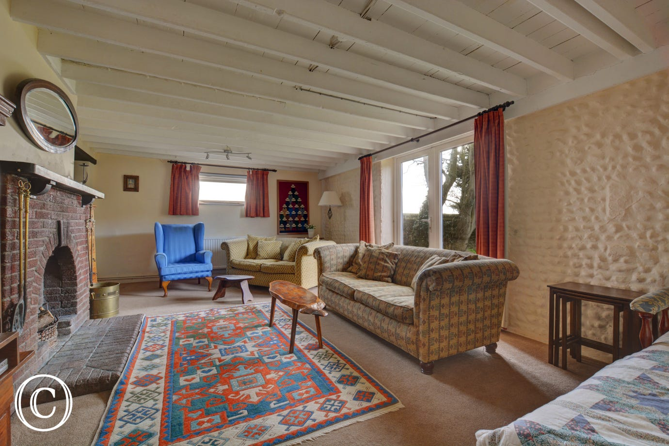 The sitting room is spacious and has large comfy sofas,  plenty of room for all the family