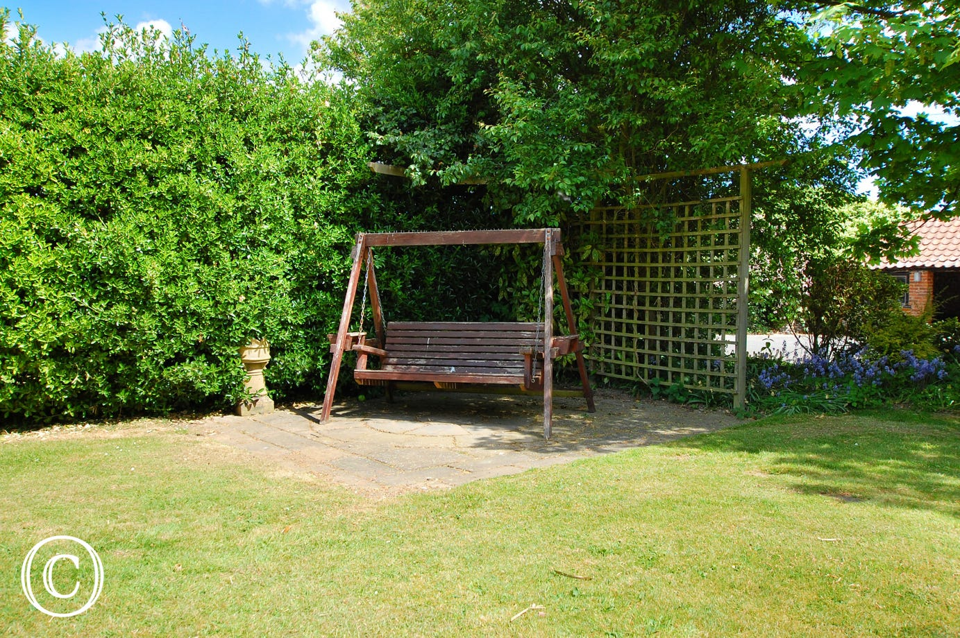 Within the garden there is a delightful swing, a lovely place to relax and enjoy the outdoors