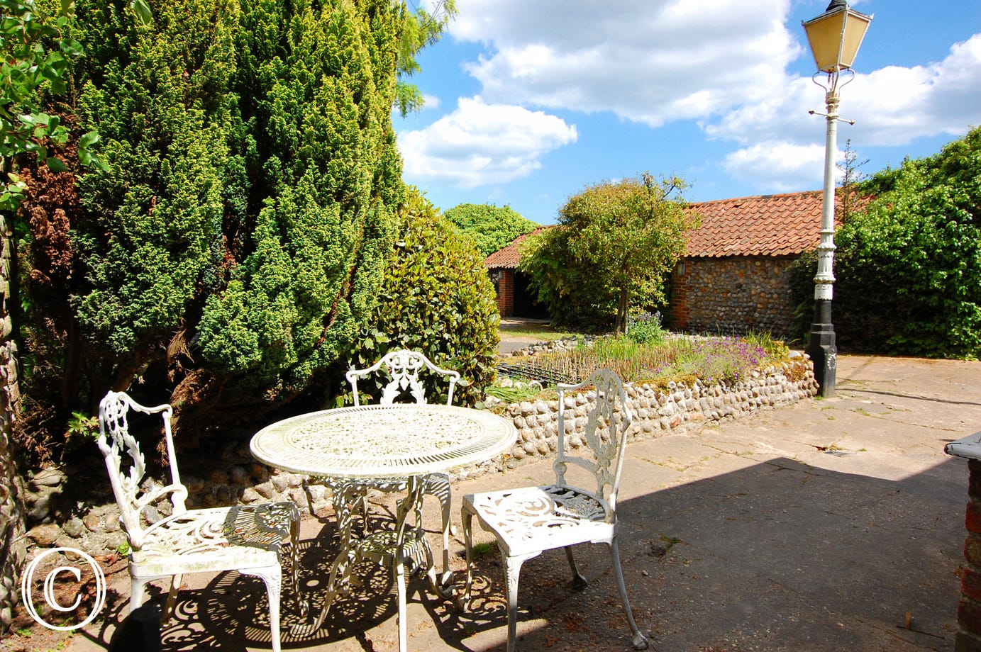 The patio has garden furniture and a barbecue, perfect for al fresco dining