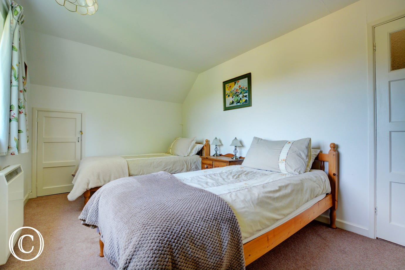 Country style double bedroom with pine twin beds