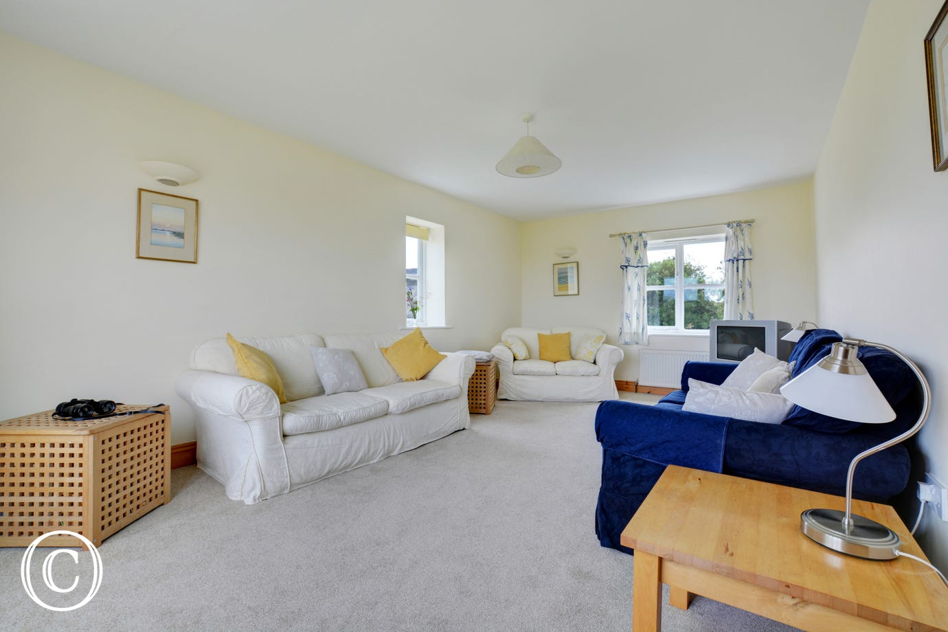 First floor sitting room attractively furnished with comfortable seating and plenty of space for all the family