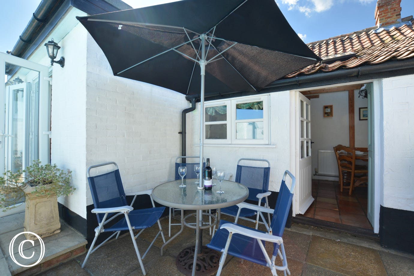 Lovely patio area with furniture and parasol