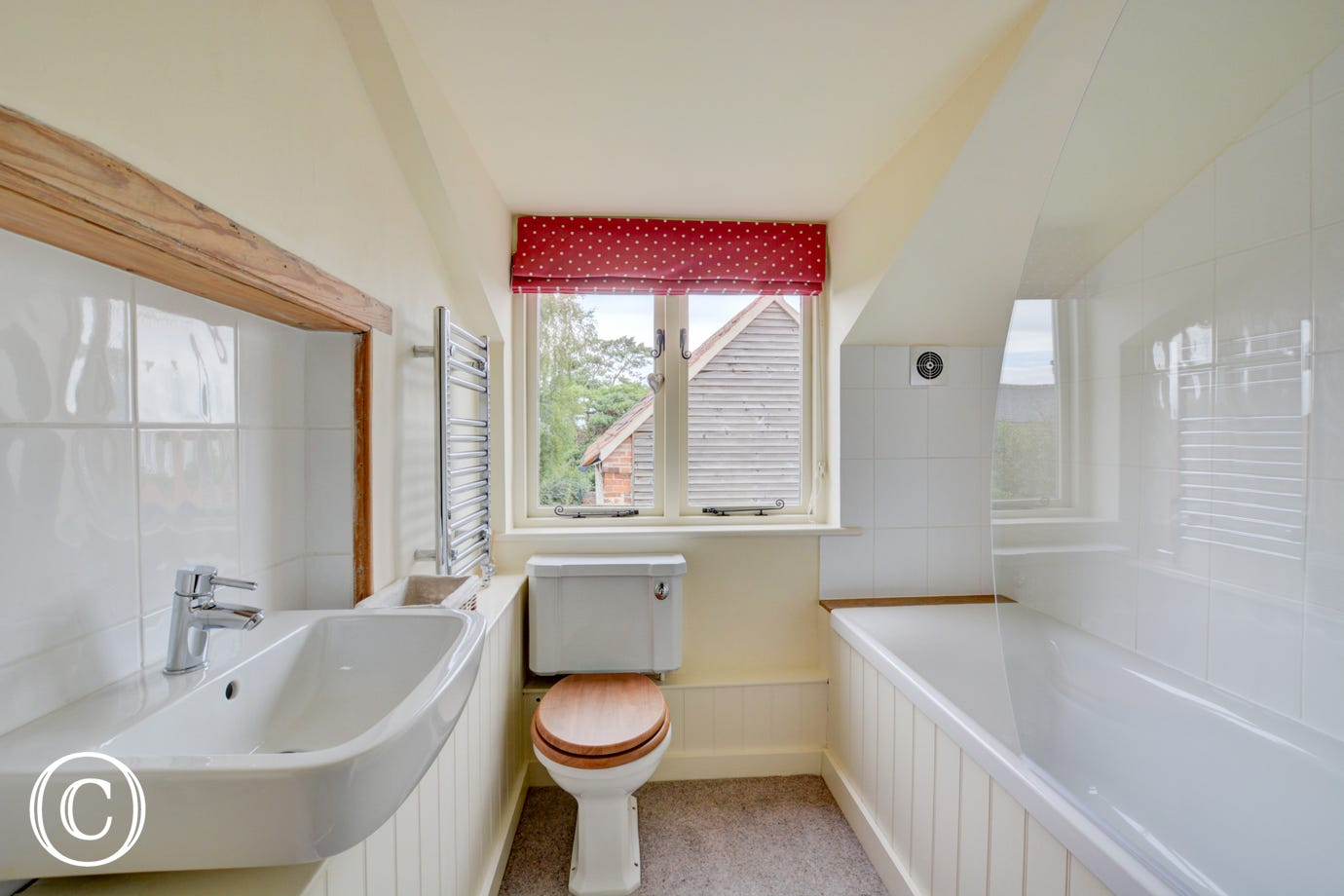 Bathroom with bath, over bath shower, washbasin and wc