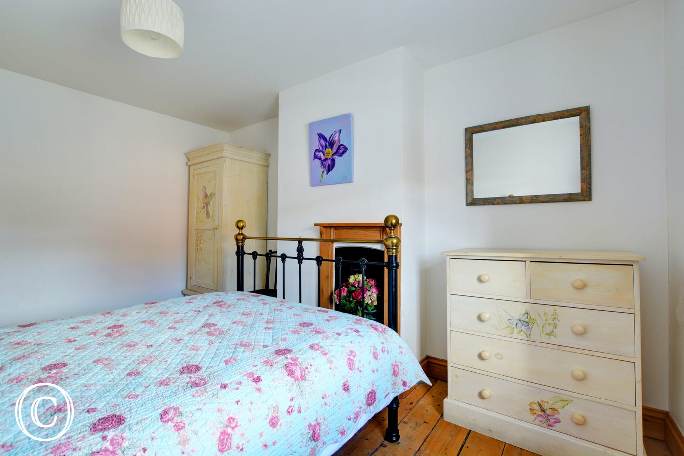 Charming double bedroom with delightful hand painted bedroom furniture