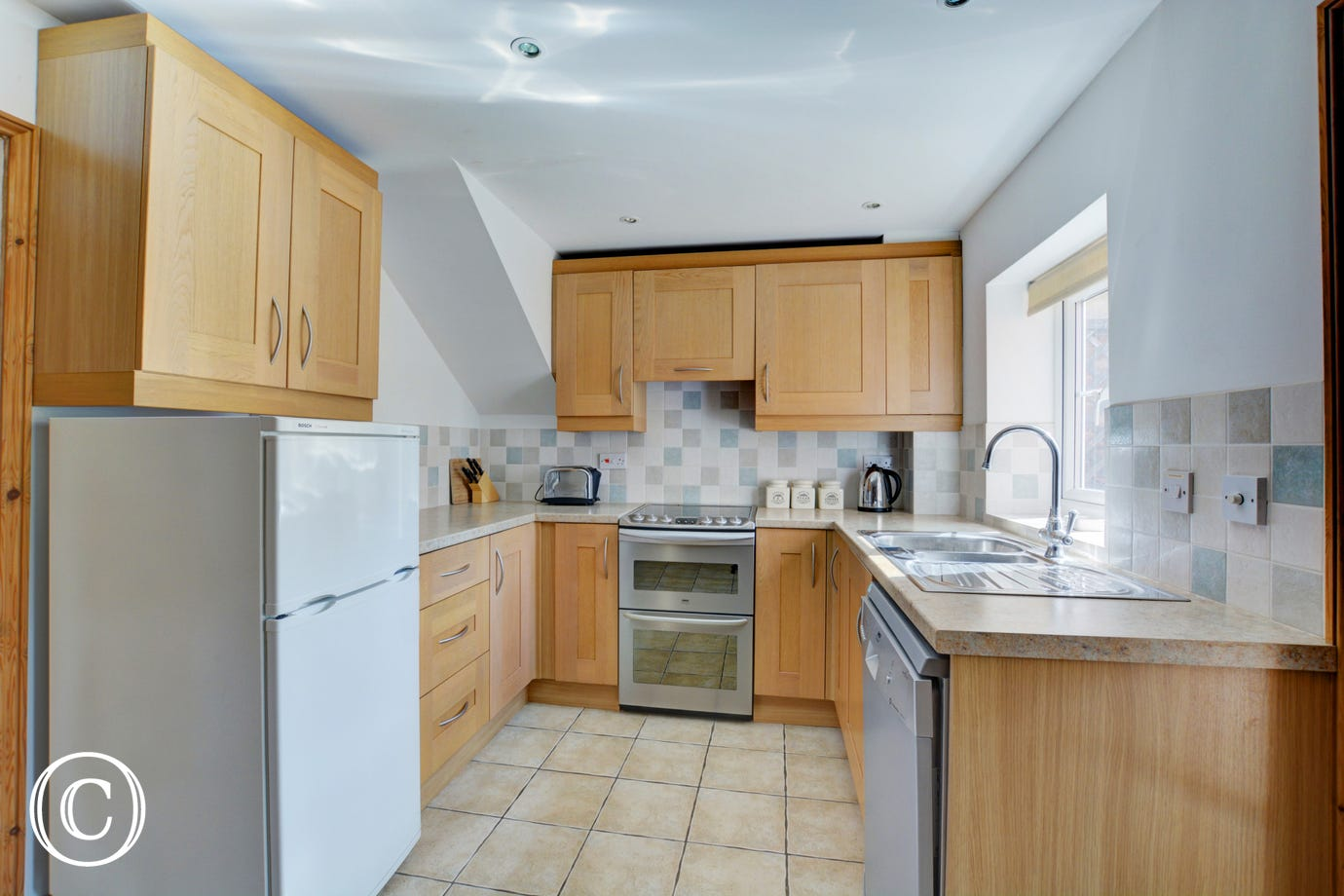 Modern, bright, contemporary kitchen with the added benefit of a shared utility room and a ground floor WC