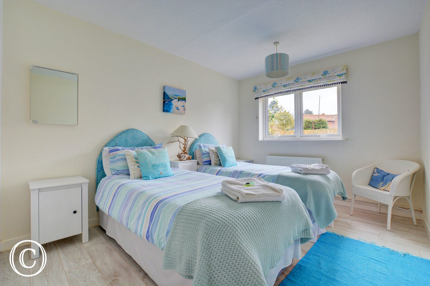 Bedroom one has twin beds making it ideal for adults or children alike.  The colour theme is blue.