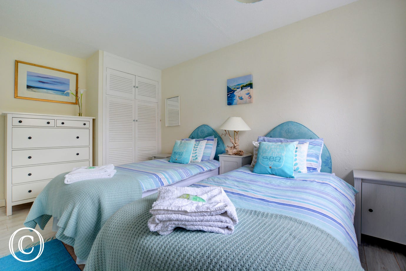 Here, looking across the twin beds, we focus on the built in wardrobe and the dressing table.