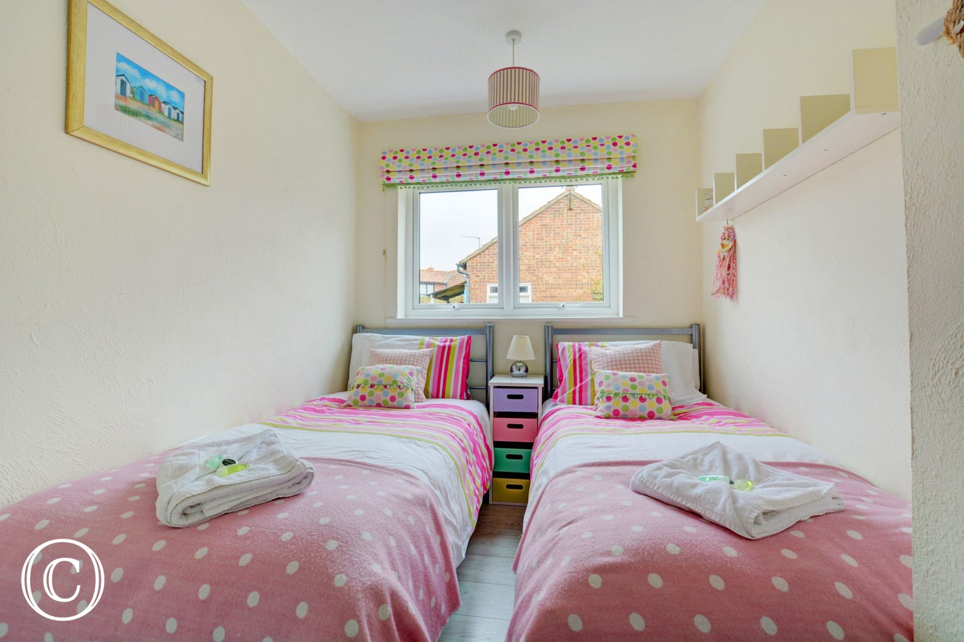 Bedroom two also has twin beds.  The colour theme for this room is pink.