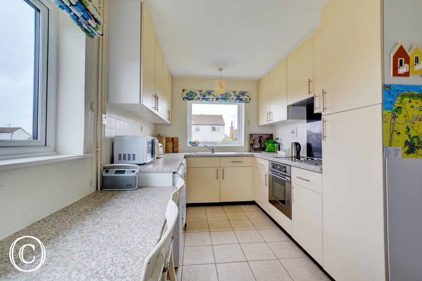 The kitchen is modern and well equipped with a dishwasher and washing machine.