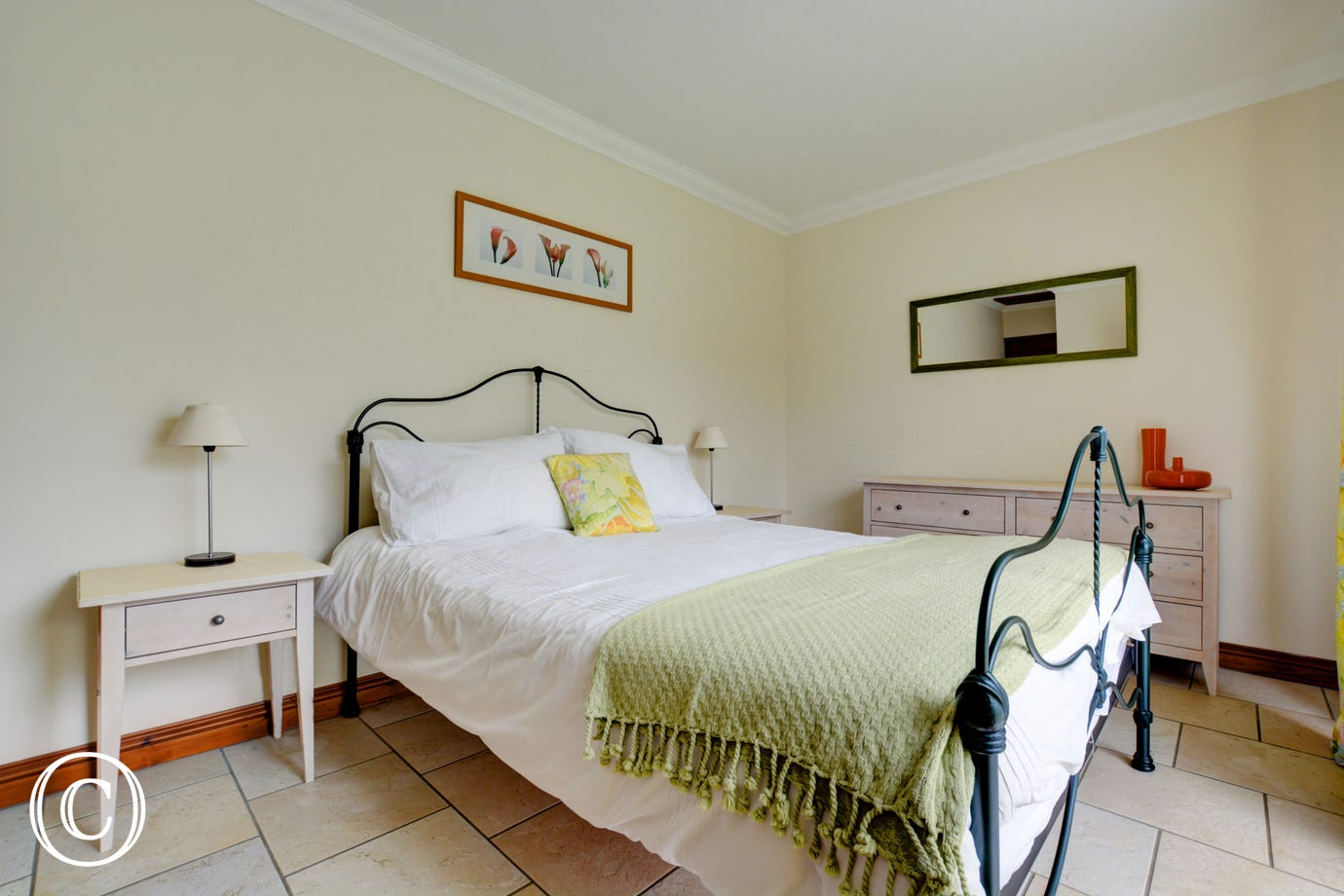 A comfortable kingsize bed in the spacious ground floor bedroom