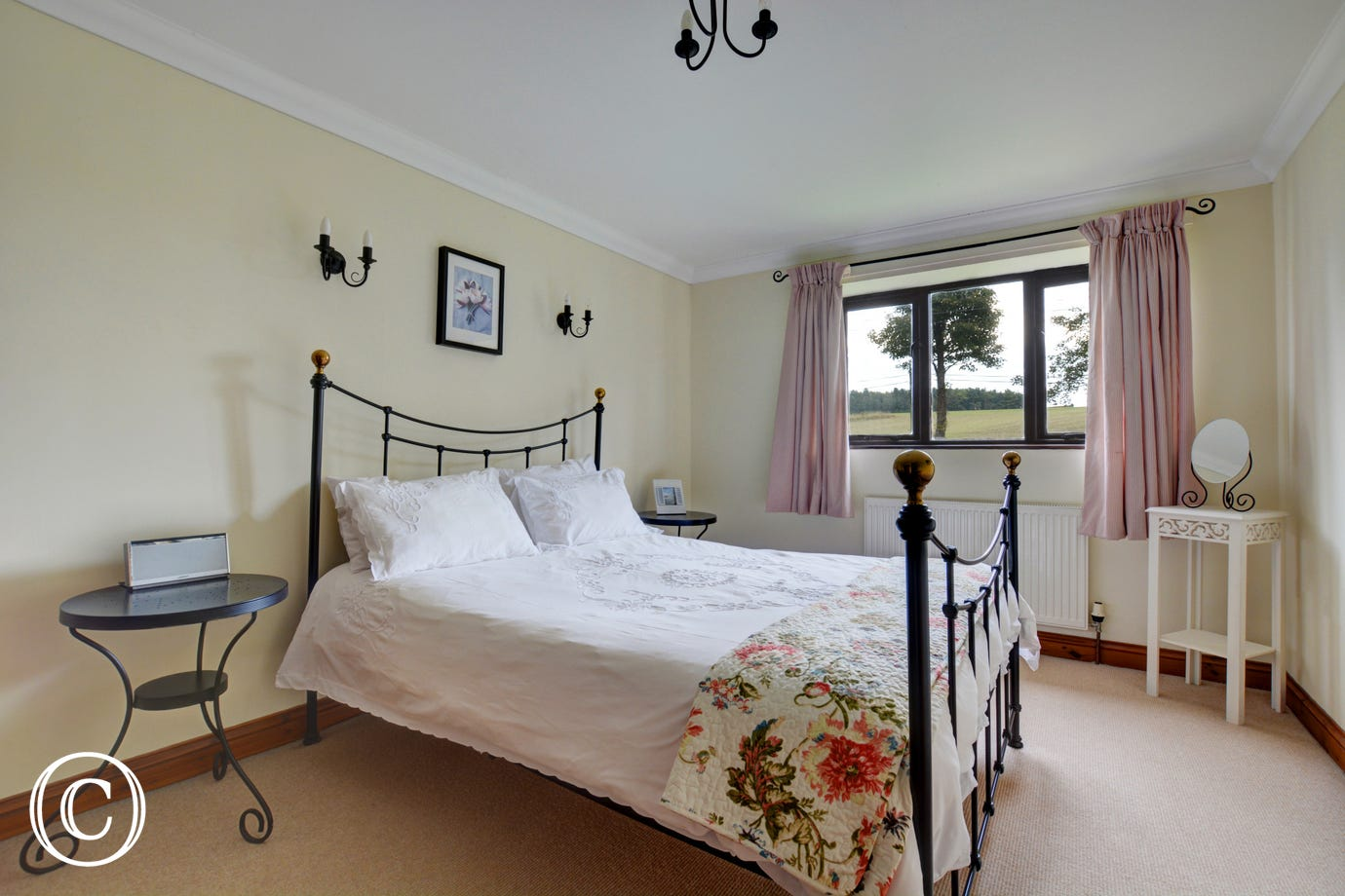 This comfortable king size bedroom which is a light and spacious room has the benefit of an ensuite bathroom