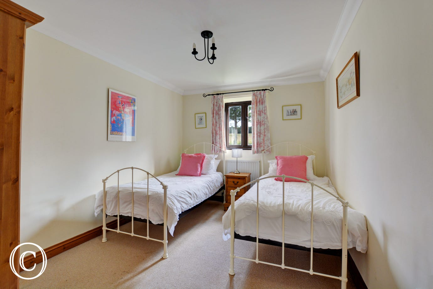 The pretty twin bedroom is light and airy