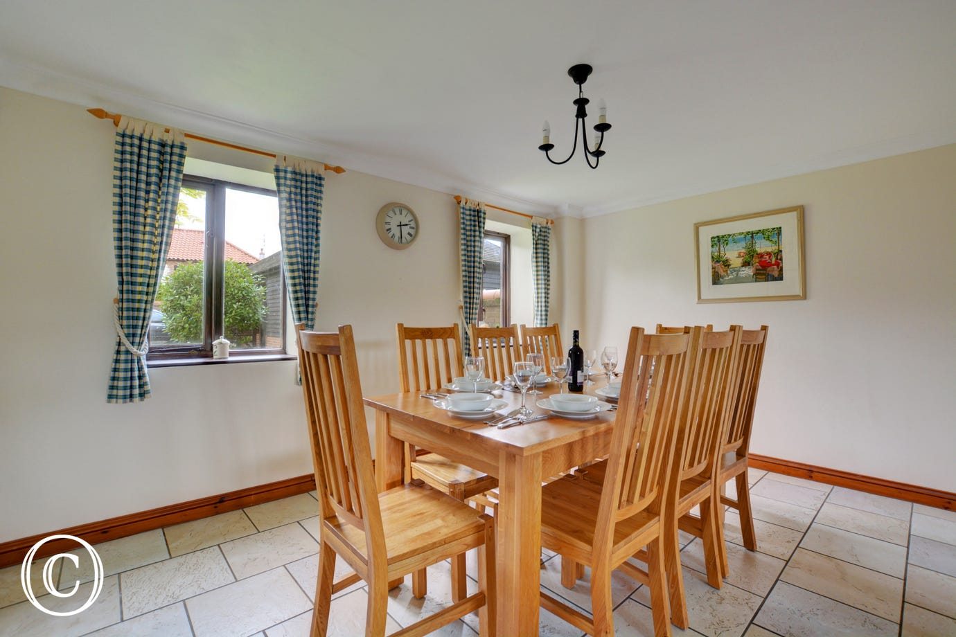 This lovely spacious dining room opens off the kitchen and is the perfect place for family meals