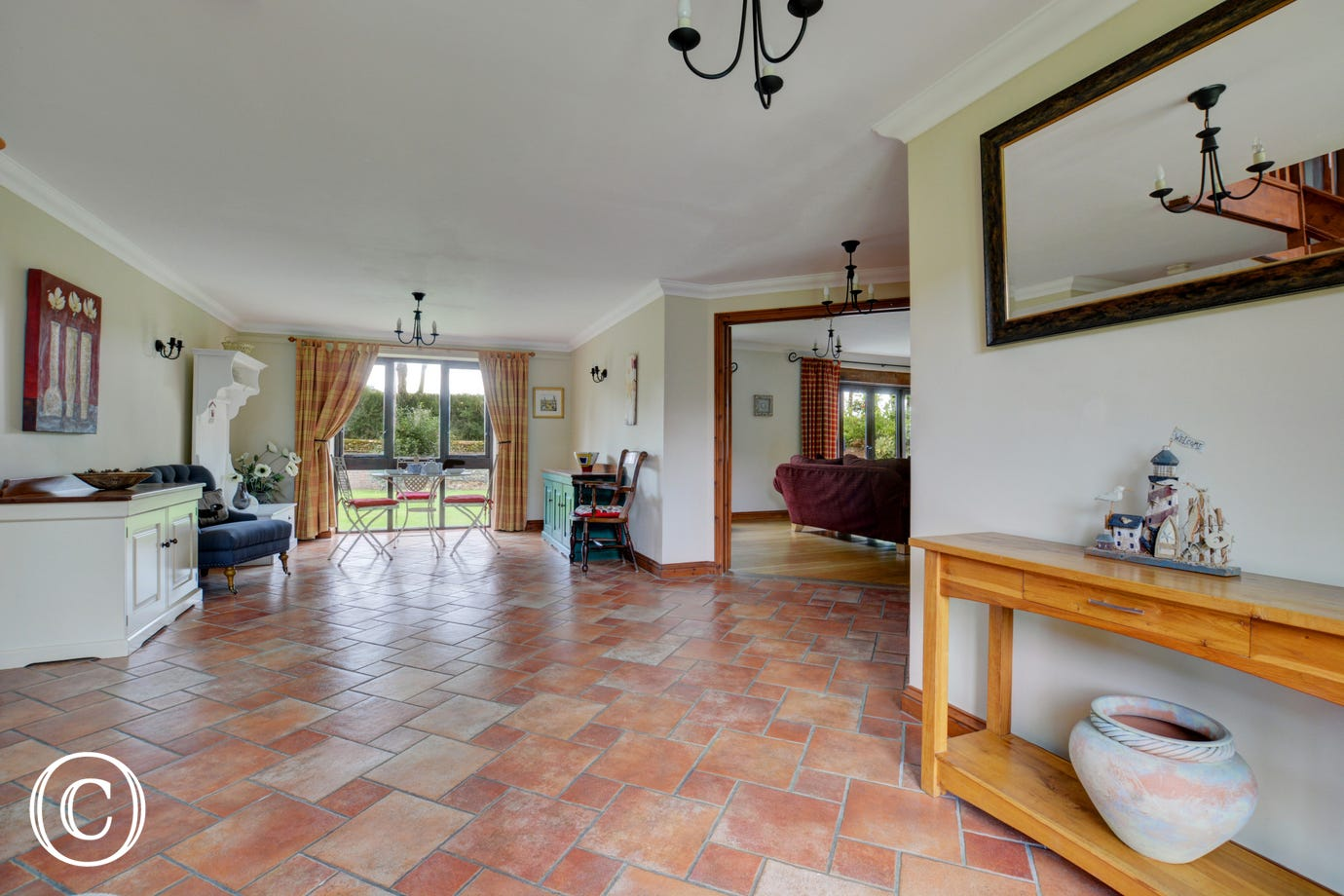 The lovely spacious entrance hall is at the centre of this super family house