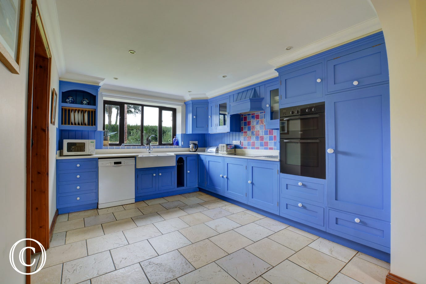 Large modern well equipped kitchen overlooking the rear garden