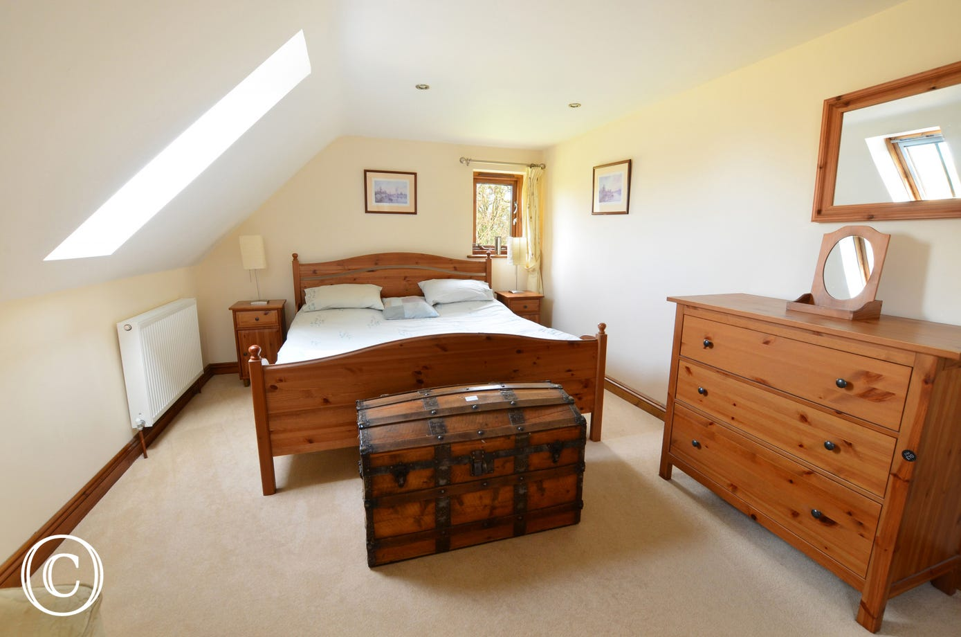 This double room has a sloping ceiling with a velux window and is a bright and airy