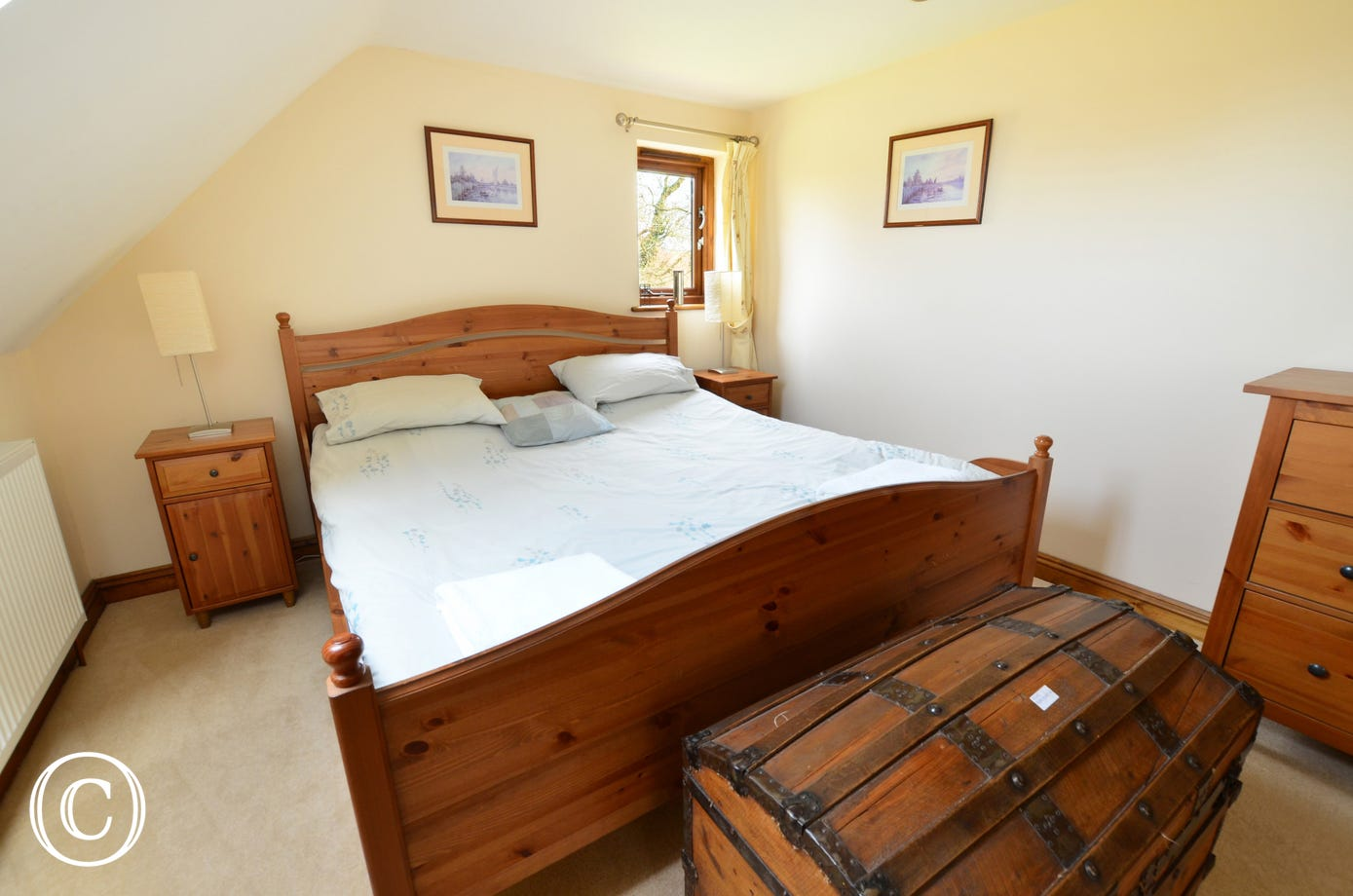This charming double room has a pine super king size bed and a sloping ceiling