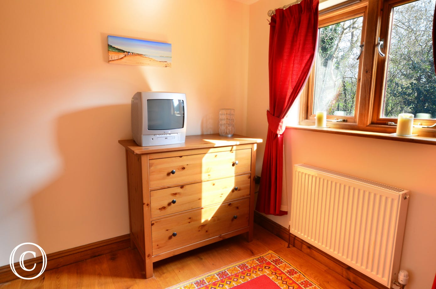 There is a flatscreen TV with Freeview and a combined DVD player in bedroom four, ideal when younger members of the group wish to do their own thing !