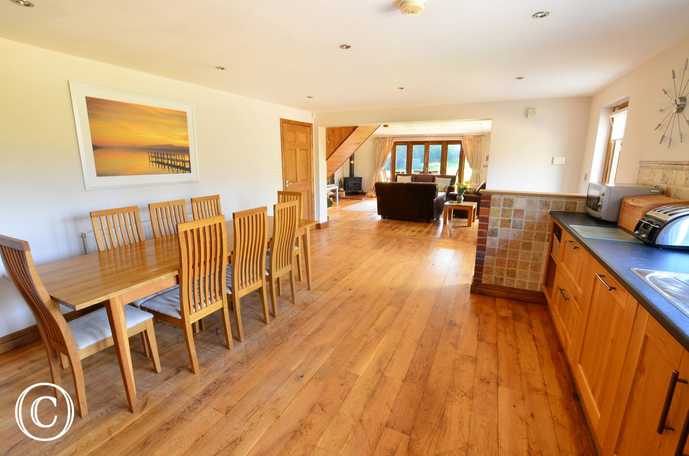 The spacious kitchen/dining room leads through to the lovely sitting area and has the added bonus of an utility room