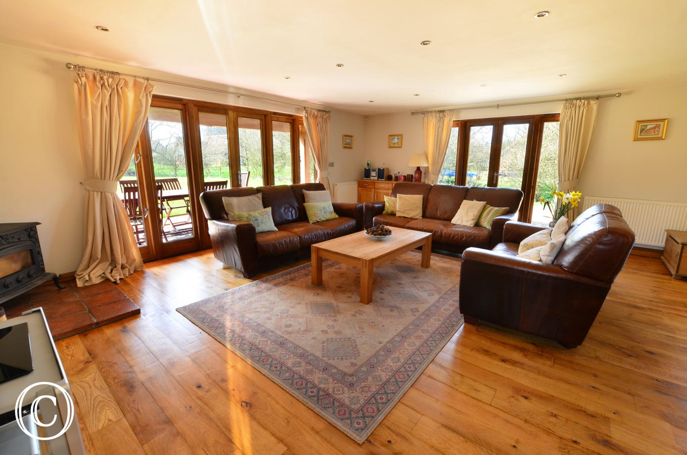The sitting area is a lovely space to relax in and the attractive rug and wood burner ensures you are warm and comfortable