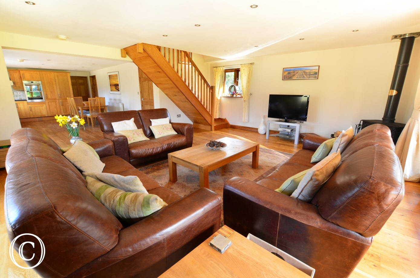 The sitting room has a wide screen TV with Sky and the attractive pine stairs lead up to the first floor.