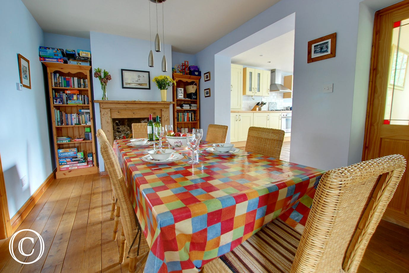 Spacious dining room with a long table and six chairs, a lovely area for family meals
