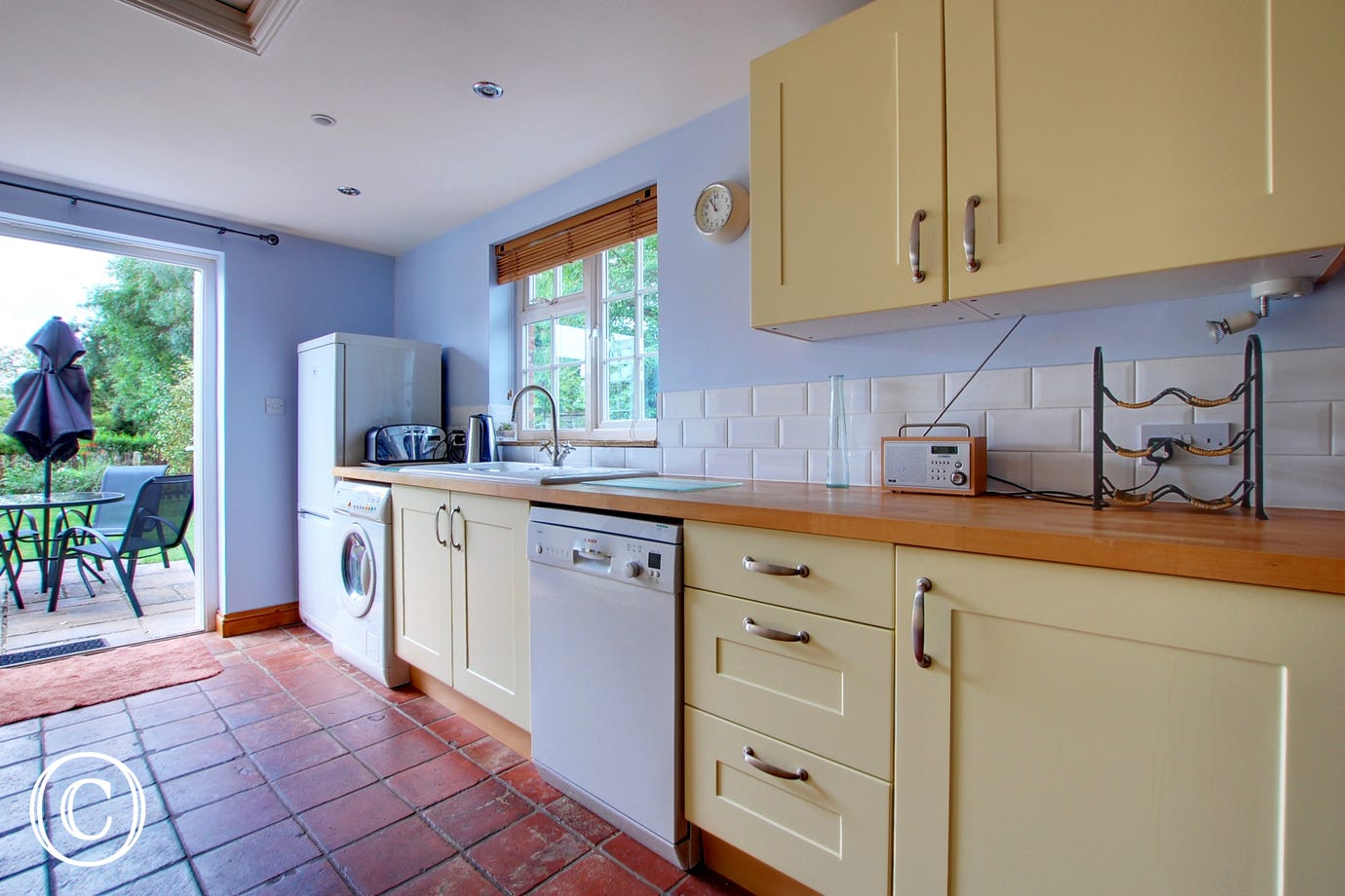 The kitchen is fully fitted with shaker style cream units and a good range of appliances