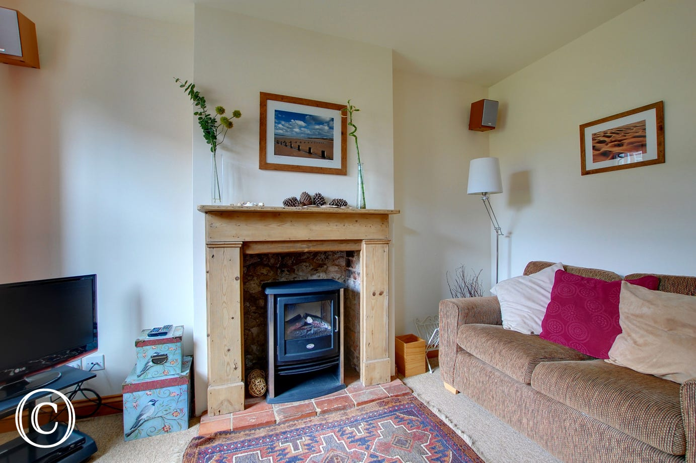 The sitting room has an attractive fire place with an electric living flame fire that supplements the gas central heating and gives a cosy feel