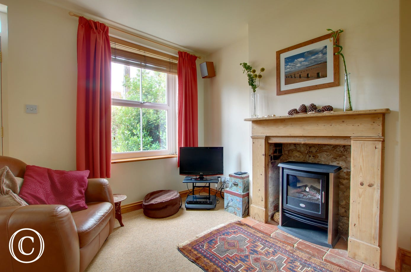 In the sitting room there is a TV with Freeview together with a DVD for family entertainment
