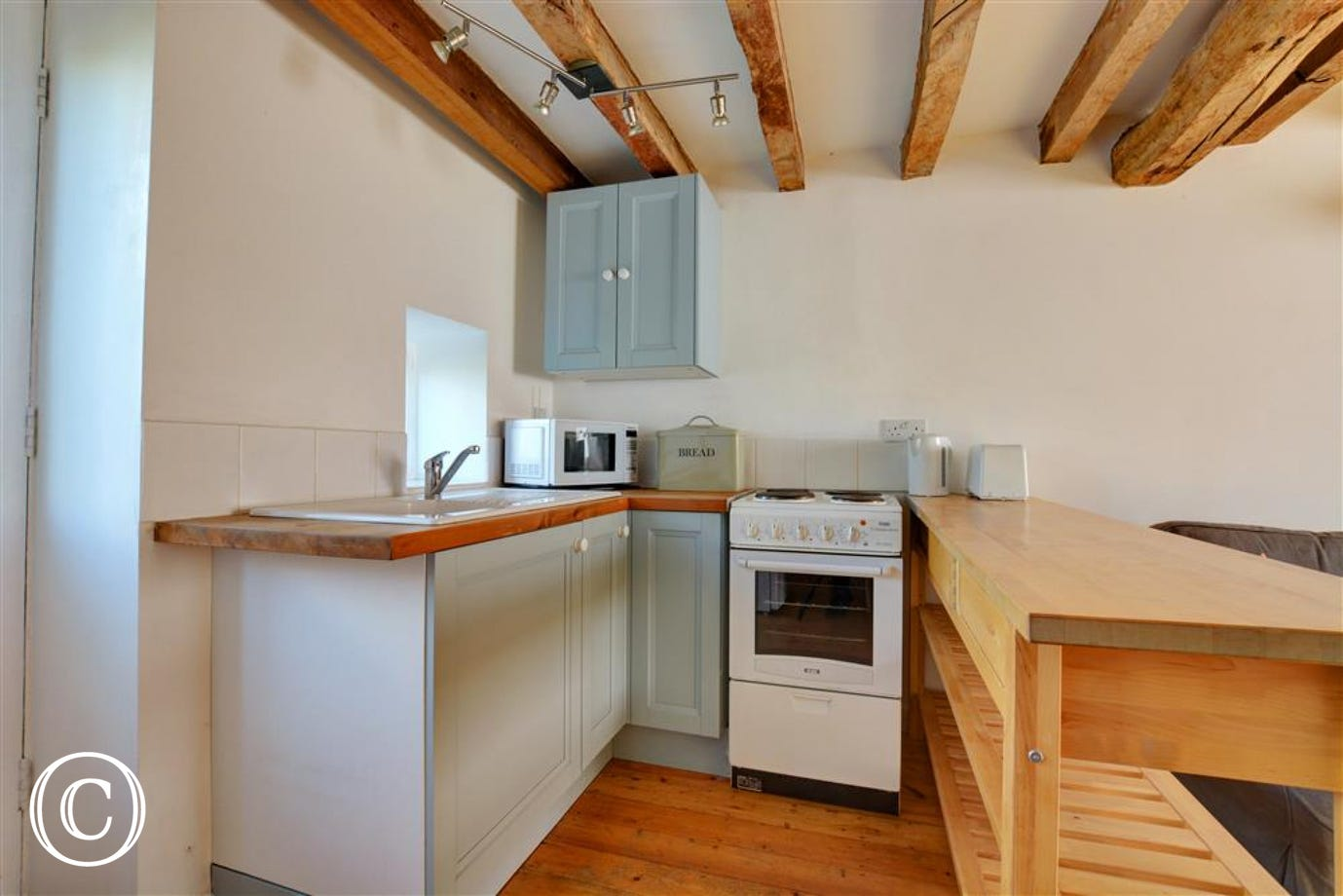 Compact kitchen area within the open plan living space