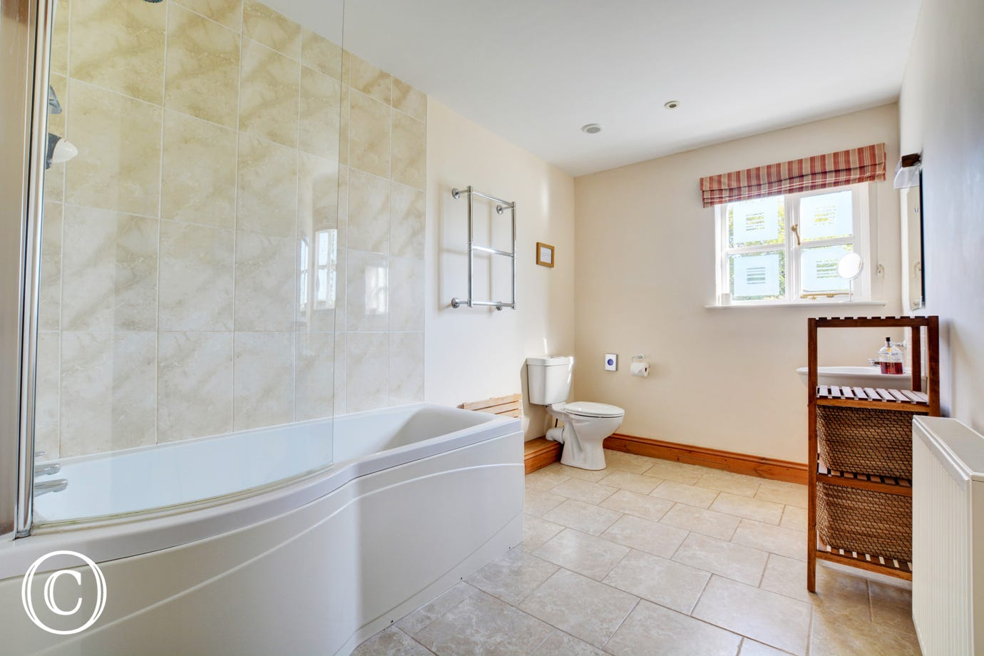 Stunning modern bathroom with bath and overbath shower