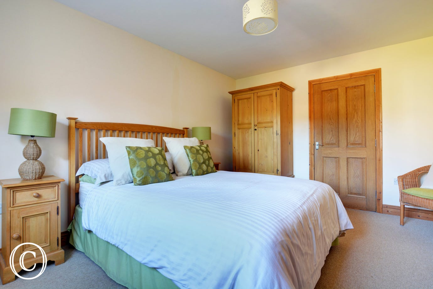 The double bedroom is stylishly furnished with a double bed, comfortable seating and ample storage