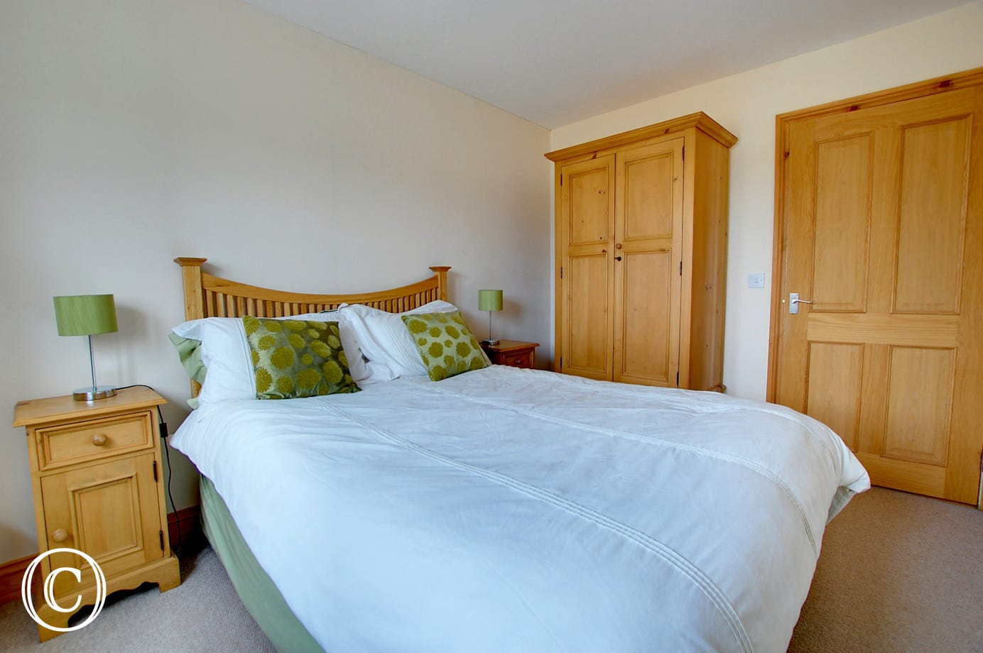 Another angle of bedroom 3 showing the beautiful soft furnishings and storage