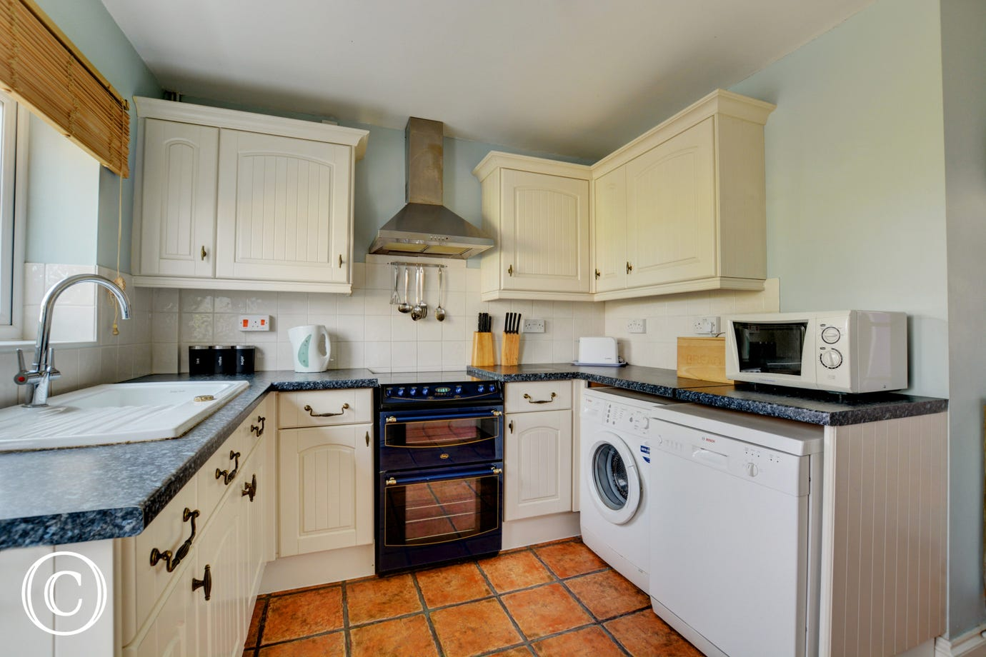 Well equipped, modern kitchen with an electric cooker