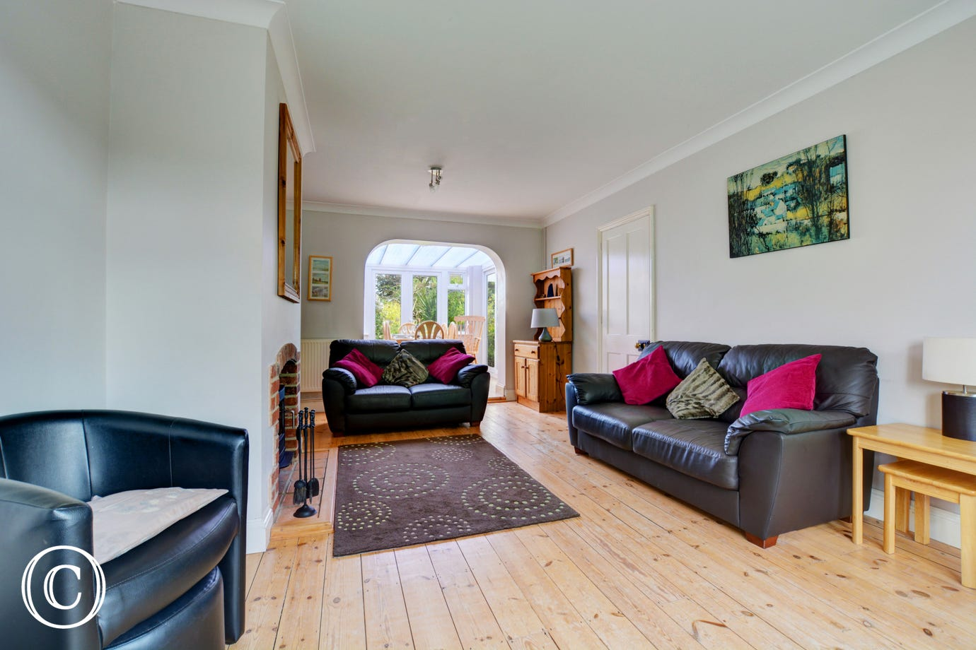 Comfortable sofas and a woodburner makes this a lovely cosy sitting room